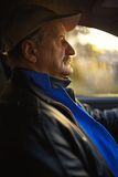 Old man with moustaches driving a car Stock Photo