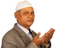 Old man muslim. Hands with muslim prayer beads stock photo