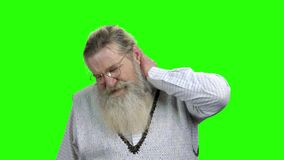 Old man with neck pain on green screen. stock footage