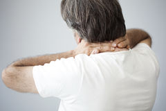 Old man with neck pain Stock Photo