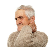 Old man with neck pain Stock Photography