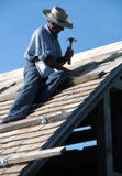 Old Man New Old Roof. A man re-enacting roof construction during the 19th century Royalty Free Stock Photography