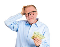 Old man not sure of spending Royalty Free Stock Images