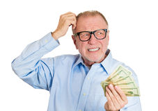 Old man not sure of spending Royalty Free Stock Photography