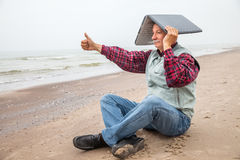 Old man with notebook on beach Royalty Free Stock Image