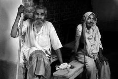 Old man & old woman. Poor villagers are waiting for the doctor in a temporary medical camp Royalty Free Stock Images