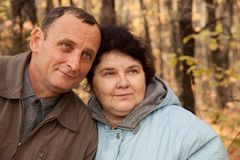 Old man and old woman in autumnal forest Stock Image