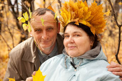 Old man and old woman with wreath of maple leaves Stock Image