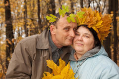 Old man and old woman with wreath of maple leaves Royalty Free Stock Photo