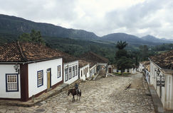 Free Old Man On A Horse Along An Unspoiled Colonial Street In Tiradentes, Brazil. Royalty Free Stock Image - 44098256