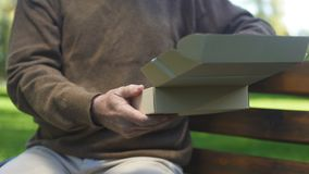 Old man opening carton box and looking photo, past memories, nostalgia, archive. Stock footage stock video footage