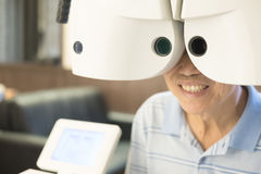 Old man with optometry. In the optical shop Stock Images