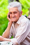 Old man outdoor. Closeup portrait of an old man outdoor, smiling Royalty Free Stock Photography