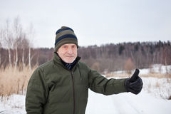 Old man outdoors. Winter time. Royalty Free Stock Photo