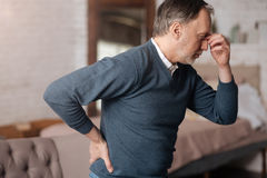 Old man with pain in back and headache Royalty Free Stock Photos