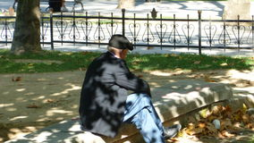 Old man in the park. Old man sitting at the autumn park Stock Photo