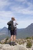 Old man photographer on mountain top 2 Stock Photo