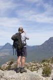 Old man photographer on mountain top 2. Portrait Stock Photo