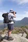 Old man photographer on mountain top. Portrait Royalty Free Stock Photo
