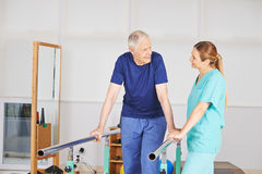 Old man at physiotherapy Royalty Free Stock Images
