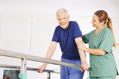 Old man in physiotherapy on treadmill Stock Photography