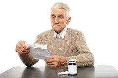 Old man with pills Royalty Free Stock Images
