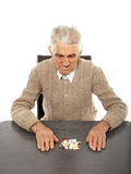 Old man with pills Stock Image