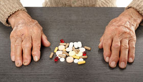 Old man with pills. Caucasian senior man taking a huge bunch of pills Royalty Free Stock Photo