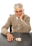 Old man with pills Royalty Free Stock Photos