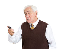 Old man pissed off at a phone conversation Royalty Free Stock Photo