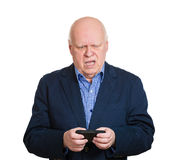 Old man pissed off at a text message Royalty Free Stock Photo