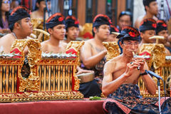 Old man play ethnic Balinese music on bamboo flute Stock Photo