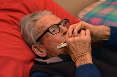 Old man play harmonica royalty free stock photos