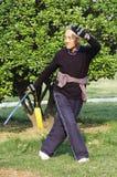 Old man play Taiji sword
