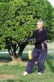 Old man play Taiji sword stock photography