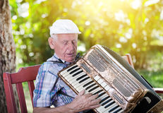 Old man playing accordion Royalty Free Stock Photo