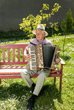 Old man playing accordion Stock Photos