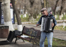 Old man is playing on the accordion on the streets of Yerevan. Armenia. Stock Image