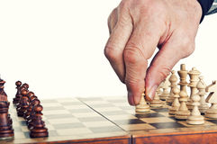 Old man playing chess. Isolated on a white background Stock Image
