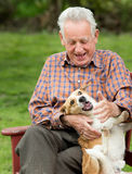 Old man playing with dog Royalty Free Stock Photography