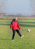 Old man playing football Royalty Free Stock Images