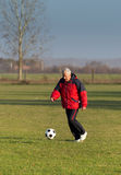 Old man playing football Royalty Free Stock Photo