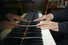 Old Man Playing The Piano Royalty Free Stock Photo