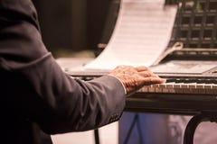 Old man playing piano Royalty Free Stock Image
