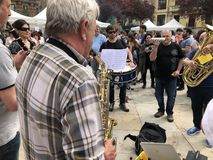 Old man playing the saxophone in Pamplona royalty free stock photography