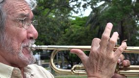Old Man Playing Trumpet stock footage