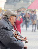 Old man playing the violin Stock Photography