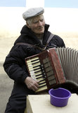 The old man plays the accordion. Old man trying to make a living Stock Photos