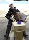 The old man plays the accordion. Old man trying to make a living Stock Images
