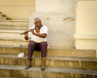 Old man plays flute in Havana, Cuba Stock Image